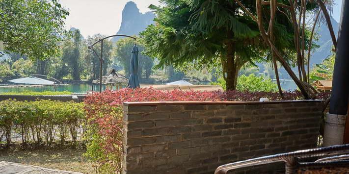 Enjoy a shaded terrace with beautiful views of the Yulong River and Yangshuo Mountain Retreat garden.