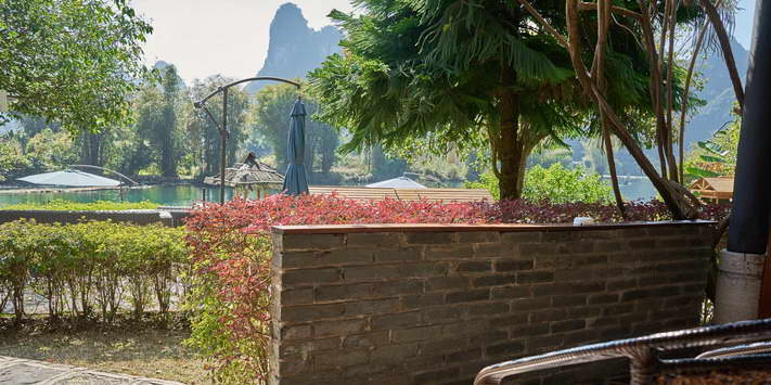 Enjoy a shaded terrace with beautiful views of the Yulong River and Yangshuo Mountain Retreat garden.