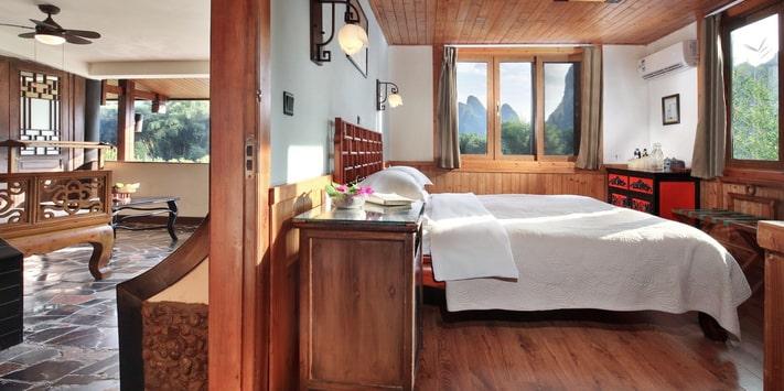 Yangshuo Mountain Retreat Yulong River corner room with oversize balcony.